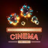 Segno al neon Cinema e fuoco d'artificio Fotografia Stock