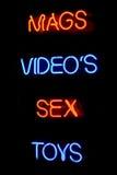 Segno al neon del negozio del sesso immagine stock