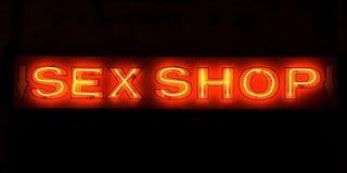 Segno al neon del negozio del sesso fotografia stock libera da diritti