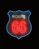 Segno al neon dell'itinerario 66 Fotografia Stock Libera da Diritti