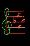Segno al neon della nota di musica fotografie stock libere da diritti