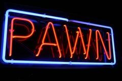Segno al neon rosso e blu del negozio di pegno Fotografie Stock