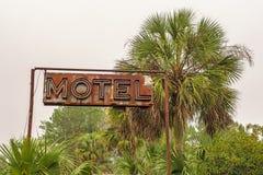 Segno al neon rustico del motel Immagine Stock Libera da Diritti