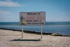 Segno alla spiaggia di Higgs, Key West, Florida fotografia stock