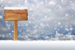 Segno in bianco innevato su un fondo del fiocco di neve di Natale Immagini Stock Libere da Diritti