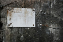 Segno in bianco sulla parete Immagine Stock