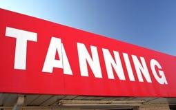 Segno d'abbronzatura sul negozio di alimentari Immagine Stock Libera da Diritti