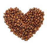 Segno del cuore fatto dei chicchi di caffè arrostiti Immagini Stock