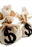 Segno del dollaro sui sacchi Immagini Stock