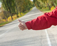 Segno del Hitchhiker Fotografia Stock