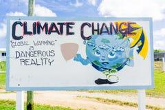 Segno del mutamento climatico con il messaggio di avviso Immagine Stock Libera da Diritti