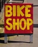 Segno del negozio della bici Fotografie Stock