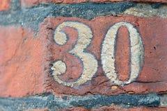 Segno del numero civico 30 Fotografie Stock Libere da Diritti