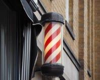 Segno del palo del barbiere fotografie stock