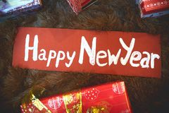 Segno del ` s del nuovo anno su una retro insegna di legno Fotografia Stock