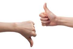 Segno del segno della tenuta di due mani buon e cattivo fotografie stock