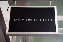Segno del Tommy Hilfeger immagine stock