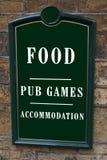 Segno dell'hotel alimento, giochi del pub, sistemazione Immagine Stock Libera da Diritti