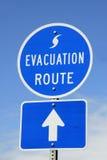 Segno dell'itinerario dell'evacuamento Immagini Stock Libere da Diritti