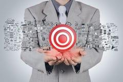 Segno dell'obiettivo della mano 3d dell'uomo d'affari Immagine Stock Libera da Diritti