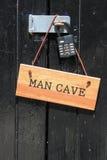 Segno della caverna dell'uomo Fotografia Stock Libera da Diritti