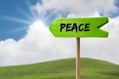 Segno della freccia del segno di pace fotografie stock