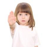 Segno della mano di arresto di gesti della neonata fotografia stock