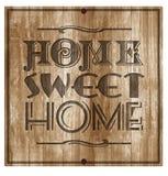 Segno della placca inciso legno della casa dolce casa fotografia stock libera da diritti