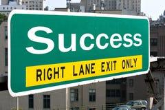 Segno della strada principale di successo Immagini Stock