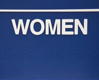 Segno delle donne con braille. Fotografie Stock