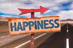 Segno di felicità con il fondo della strada Fotografia Stock