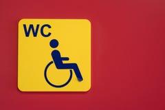 Segno di handicap della sedia a rotelle fotografia stock libera da diritti