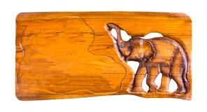 Segno di legno che scolpisce progettazione bianca isolata del fondo Fotografia Stock Libera da Diritti
