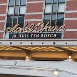 Segno di Okura dell'hotel al parco a tema del Huis ten Bosch nel Giappone immagine stock libera da diritti