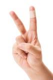 Segno di pace con il dito rattoppato Fotografie Stock Libere da Diritti