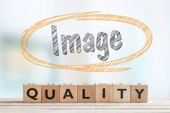 Segno di qualità di immagine su una tavola Fotografia Stock