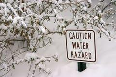 Segno di rischio dell'acqua Fotografie Stock