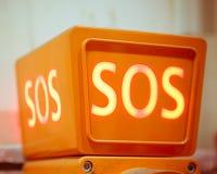 Segno di SOS, vista del primo piano Fotografie Stock Libere da Diritti