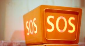Segno di SOS, vista del primo piano Fotografia Stock