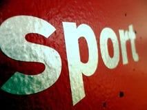 Segno di sport sulla parete rossa Fotografie Stock Libere da Diritti