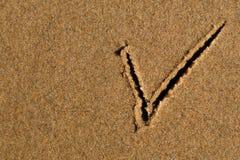 Segno di spunta nella sabbia Fotografia Stock Libera da Diritti