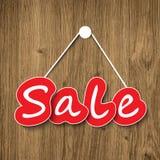 Segno di vendita su struttura di legno Fotografie Stock
