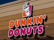 Segno e logo delle guarnizioni di gomma piuma di Dunkin Fotografia Stock