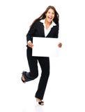 Segno emozionante della tenuta della donna di affari immagini stock libere da diritti