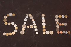 Segno fatto delle monete, grande concetto di vendita di vendita Fotografia Stock Libera da Diritti