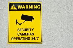 Segno giallo delle videocamere di sicurezza del cctv di avvertimento illustrazione vettoriale