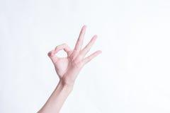 Segno GIUSTO della mano isolato su priorità bassa bianca Fotografie Stock
