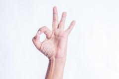 Segno GIUSTO della mano isolato su priorità bassa bianca Fotografia Stock