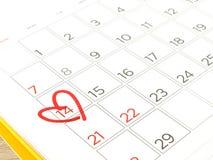 Segno rosso del cuore sul calendario a 14 Fotografie Stock