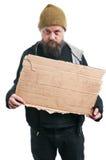 Segno senza tetto del cartone della tenuta dell'uomo Fotografia Stock Libera da Diritti